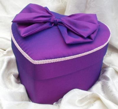 Heart shaped purple taffeta box with baby pink trimming