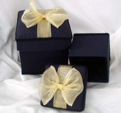 Black Moire Box topped with a Gold Organza Bow