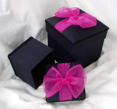 Black Moire Box topped with a Pink Organza Bow