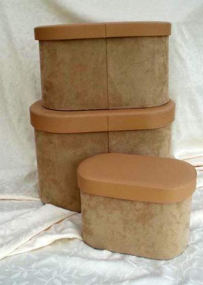 Set of oval faux suede storage boxes