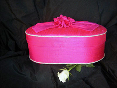 Oval Box covered in magenta pure dupion silk fabric